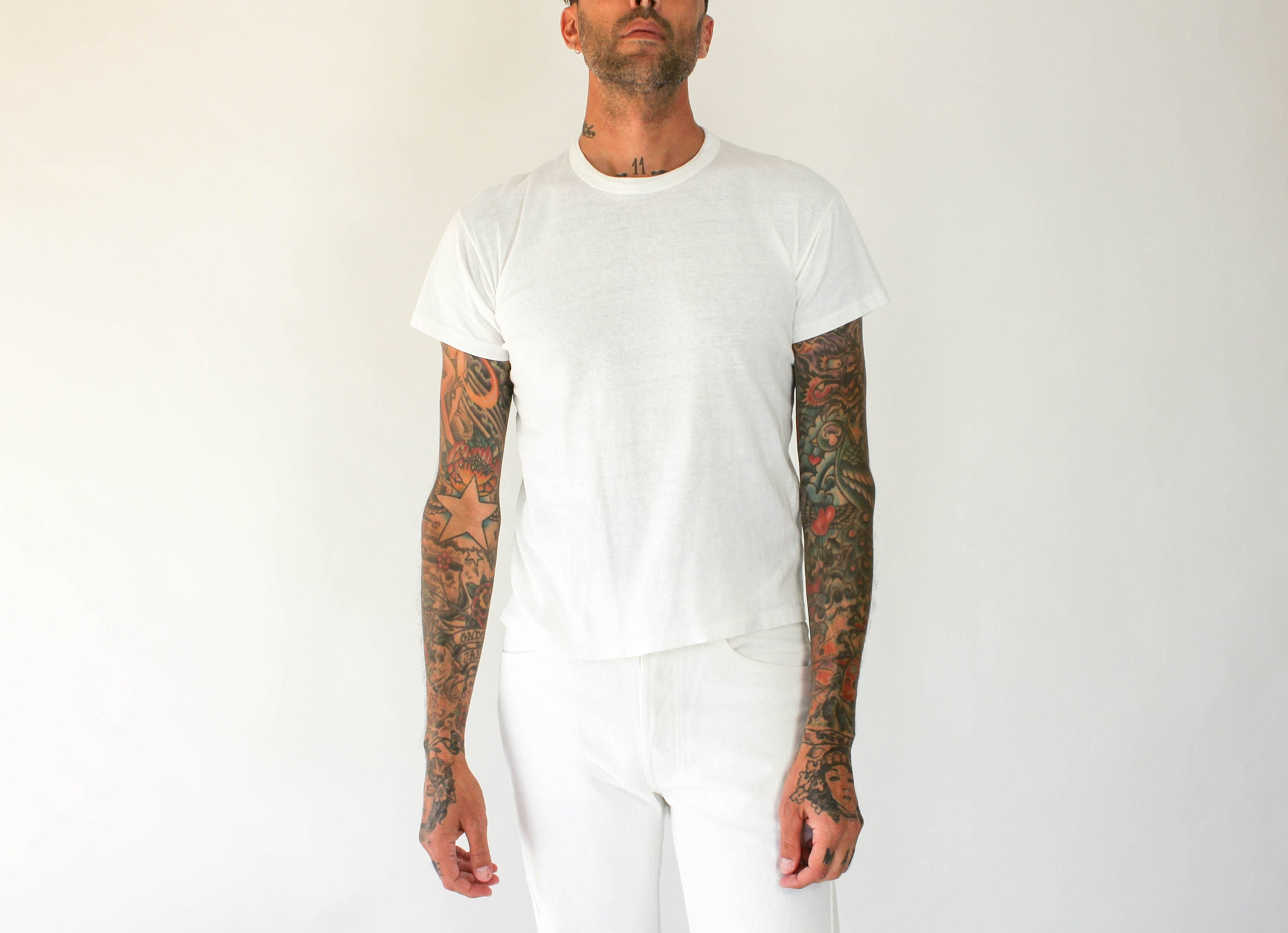 1970s Men's Shirt Styles – Vintage 70s Shirts for Guys Vintage 80S Russell Athletic Distressed Blank White Single Stitch Tee Shirt  Made in Usa 100 Gauzy Cotton 1970S Retro T-Shirt $56.00 AT vintagedancer.com