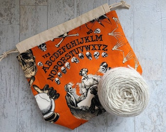 Medium halloween print project bag for knitting, crochet, needlework; seance and oujia board drawstring pouch with pockets