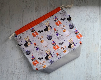 Halloween project bag for knitting, crochet, or embroidery with drawstring and pockets featuring dogs in costumes