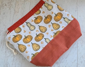 Medium project bag for knitting, crochet, needlework with fall pumpkins and gourds print; drawstring pouch with 2 inner slip pockets