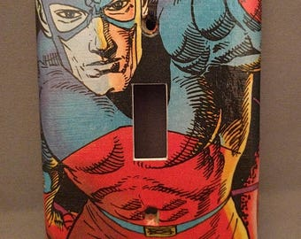 The Atom comic decoupage light switch cover