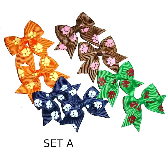 Dog bow PAIRS paw prints boys or girl colors everyday dog groomers grooming pet hair bows (fb159)