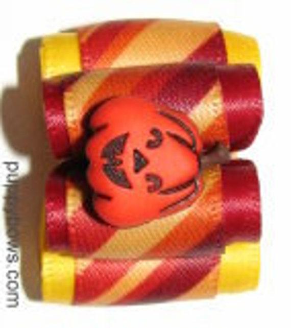 Fun little pumpkin for halloween dog grooming bow