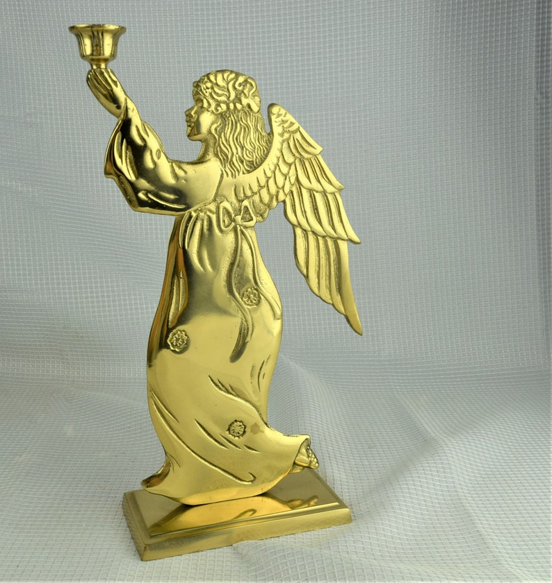 Vintage Large Brass Walking Angel Candle Holder dated 1987 by image 0
