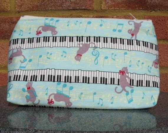 Cosmetics bag in musical cats fabric