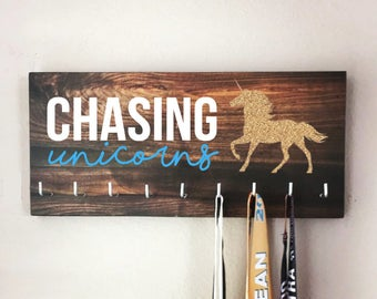 """Race Medal Holder - """"CHASING unicorns"""" white and blue with wood grain background - 16"""" wide Boston Marathon"""