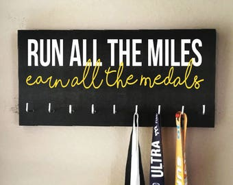"""Race Medal Holder - """"Run all the miles, earn all the medals"""" white and yellow with black background"""