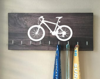 Race Medal Holder - Mountain Bike - white with dark gray wood grain background