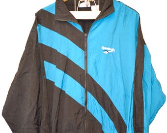 Retro 1990's Classic REEBOK Old School Patterned Windbreaker Jacket - Blue and Black - Unisex Large
