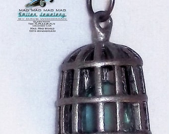 It's a Mad, Mad, Mad, Mad bird cage necklace with authentic It's a Mad4 World car glass