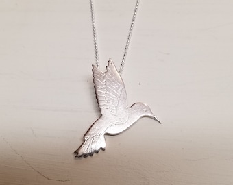 Tiny sterling silver hummingbird necklace