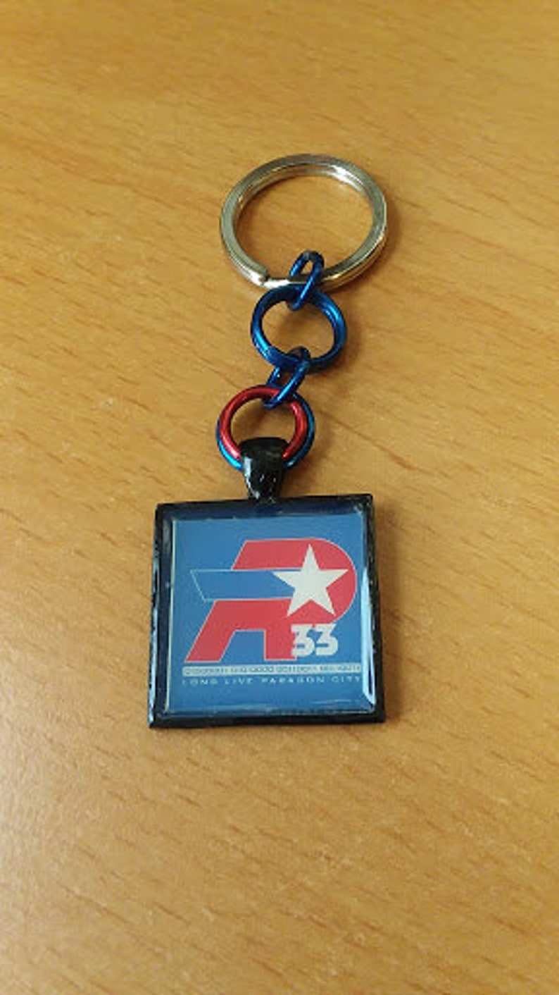 Item Number 7038 City of Heroes Remembrance AP33 Key Chain