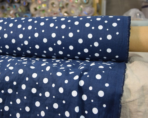 Pure 100% linen fabric Gloria Ink Blue Dotted 190gsm. White dots different sizes, rich saturated navy dark blue background. Washed-softened.