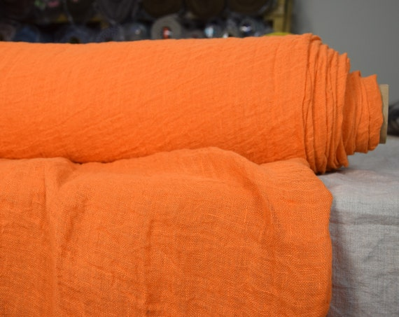 Linen fabric Pura Electric Orange. Thin semi-sheer gauze. 100% linen 110gsm. Bright rich energizing orange. Loosely woven. Washed-softened.