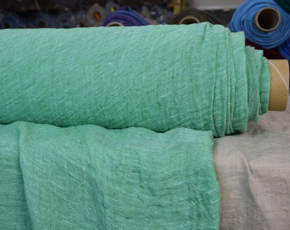 Linen fabric Pura Fresh Green Melange. Thin semi-sheer gauze. 100% linen 110gsm. Open weave (loosely woven). Washed-softened.