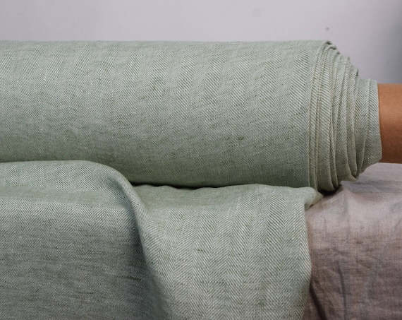 Pure 100% linen fabric Digna Green Fog 210gsm. Herringbone woven from white and pale green. Medium weight, washed-softened.