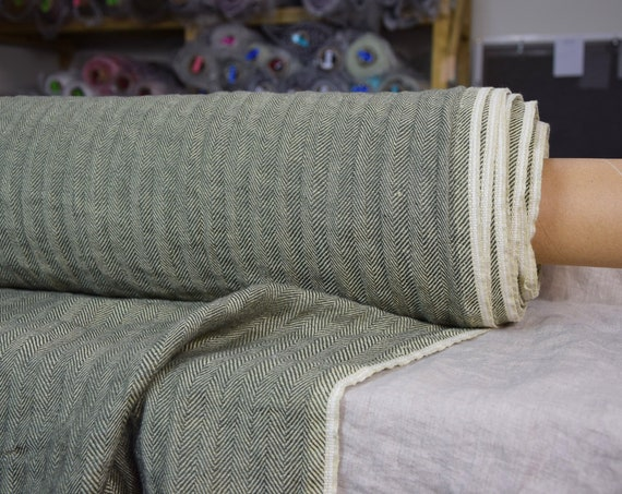 Pure 100% linen fabric Sigma Fresh Olive Herringbone 220gsm. Broken twill woven from dark green and pale green colors. Washed-softened.