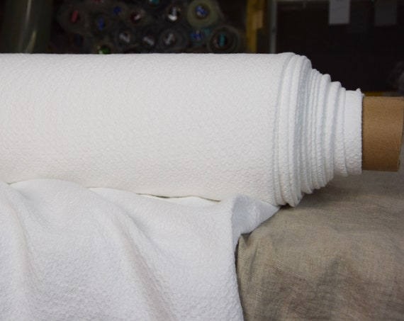 Pure 100% linen fabric Molla Stark White 260 gsm. Soft and fluffy fabric with woven uneven texture. Washed-softened.