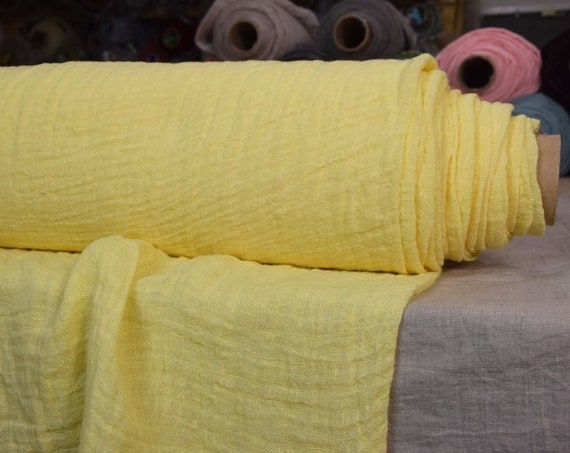 Linen fabric Pura Vivid Lemon. Thin semi-sheer gauze. 100% linen 110gsm. Bright striking vibrant yellow. Loosely woven. Washed-softened.