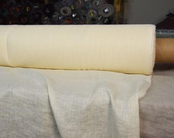 Very thin 95gsm semi-sheer pure 100% linen fabric Serena Vanilla 95gsm. Yellowish off-white tint. Washed-softened.