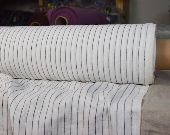 Pure 100% linen fabric Gloria Pinstripes on Off-White 190gsm. Black pinstripes at each 12mm. Washed-softened.