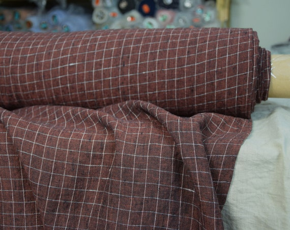 Pure 100% linen fabric Terra Maroon Melange Graph Check 210gsm (6.20oz/yd2). Dark redish-brown grid pattern. Washed-softened.