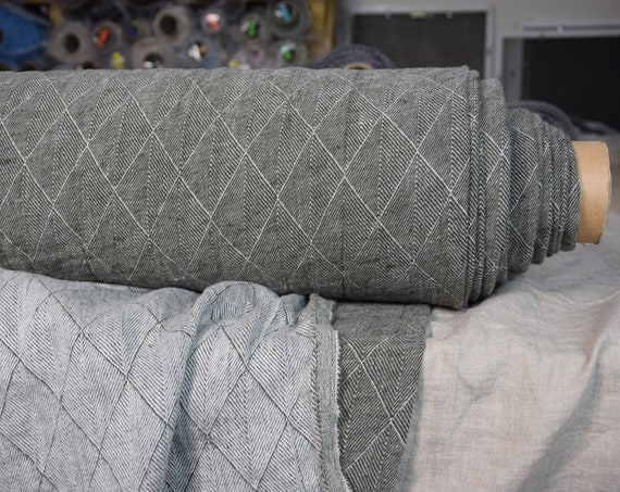 Pure 100% linen fabric Bella Olive 300gsm. Herringbone/rhombus pattern woven from white and olive-green. Washed-softened.