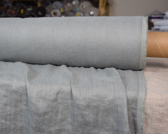Very thin 95gsm semi-sheer pure 100% linen fabric Serena Desert Sage 95gsm. Muted and dusty gray-green. Washed-softened.