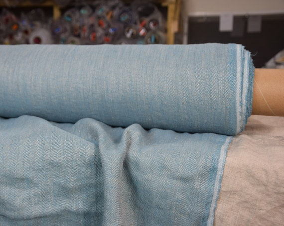 Pure 100% linen fabric Paloma Turquoise Blue Herringbone 220gsm. Woven from undyed flax and light turquoise blue. Washed-softened.