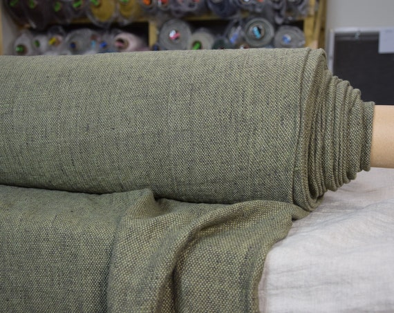Pure 100% linen fabric Montana Dried Herb 240gsm. Linen tweed woven from muted green and dark brown yarns, earthy tone. Washed-softened.
