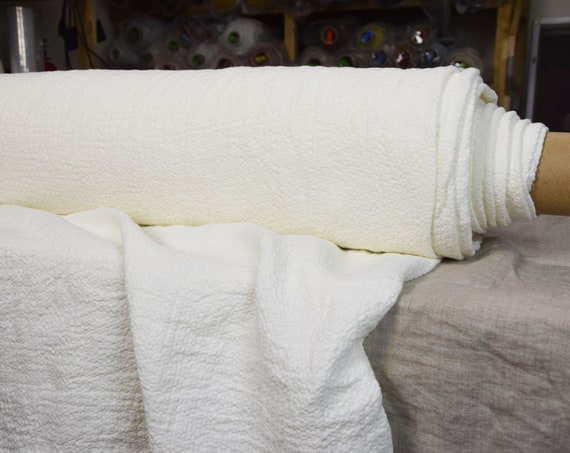 Pure 100% linen fabric Molla Off-White 260 gsm. Soft and fluffy fabric with woven uneven texture. Washed-softened.