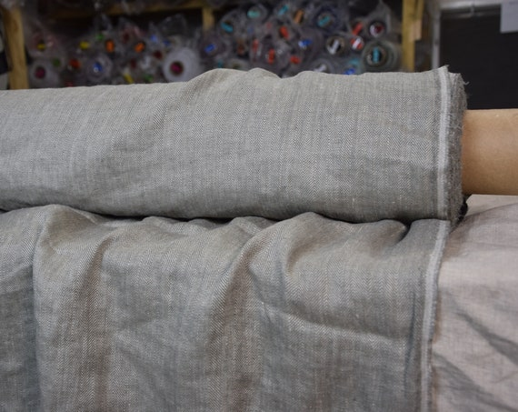 Pure 100% linen fabric Paloma Smoky Ash Herringbone 220gsm. Woven from undyed flax and gray. Washed-softened.