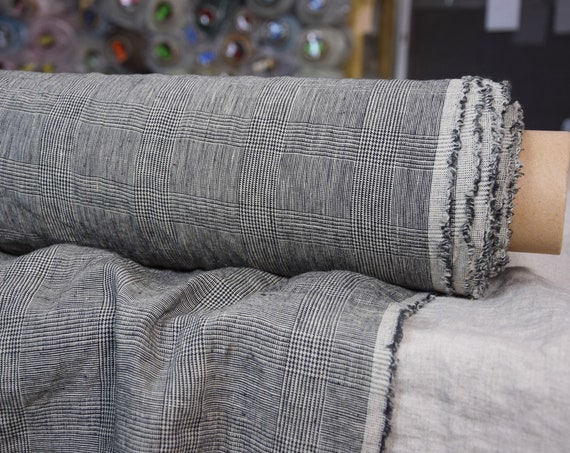 Pure 100% linen fabric Bona Glen Check Beige 210gsm. Classic glen check pattern woven from black and warm beige colors. Washed-softened.