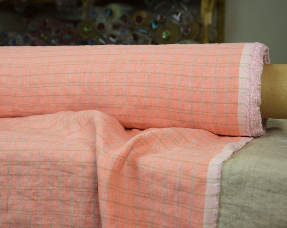 Pure 100% linen fabric 190gsm. Coral pink/rose with soft inconspicuous green and lavender grid. Middle weight, dense, washed-softened.