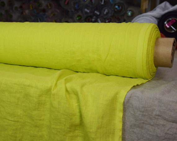 Pure 100% linen fabric Aura Evening Primrose 125gsm. Bright vibrant yellow with neon-green undertone. Washed-softened, densely woven, thin.