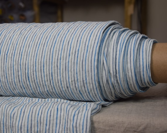 Pure 100% linen fabric Aurora Striped 160gsm. Blue, teal and gray 3mm stripes on white background . Medium-light weight, washed-softened.