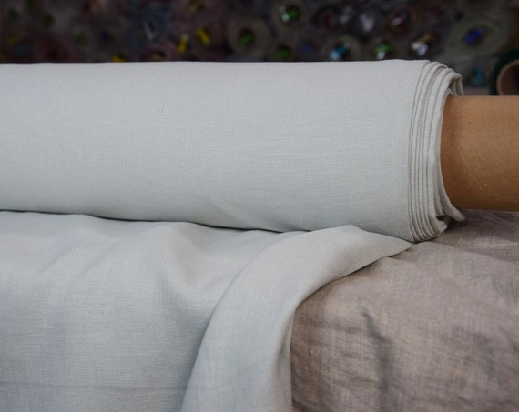 Pure 100% linen fabric Astra Whisper Green 170gsm. Pale pastel greenish color. Middle weight, dense, washed-softened.