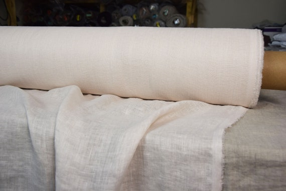 Very thin 95gsm semi-sheer pure 100% linen fabric Serena Ivory 95gsm. Washed-softened.