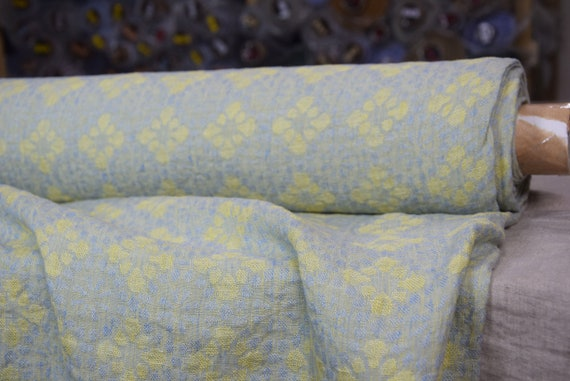 Pure 100% linen fabric Flora Blue Yellow 155gsm. Floral geometric pattern, jacquard weave, blue and yellow pastel coloring.