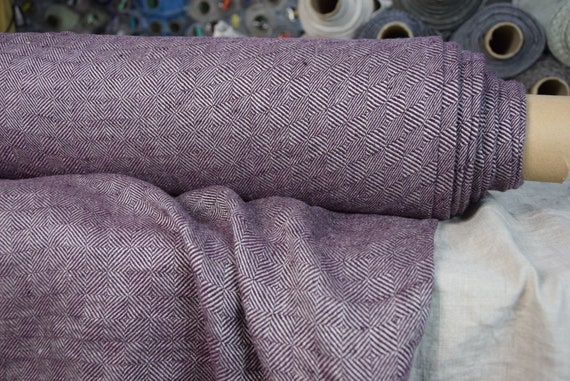 Pure 100% linen fabric Digna Purple Diamond 210gsm. Broken twill, rhombus woven from undyed flax and dark purple. Washed-softened.