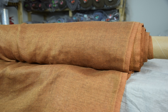 Linen/wool fabric (78/22%) Lana Aged Copper 250gsm. Rustic brown with a touch of yellow-mustard-copper hint. 2-sided, warm. Washed-softened.