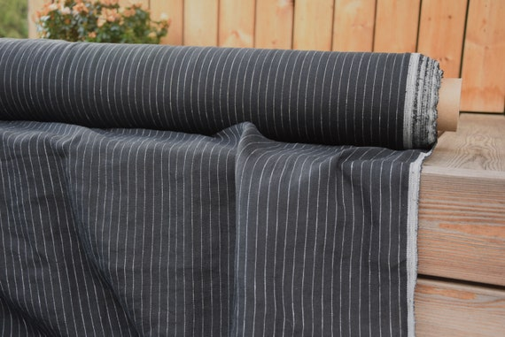Pure 100% linen fabric Aura White Pinstripes on Black 125gsm. Pinstripes at each 10mm on black background. Washed-softened.