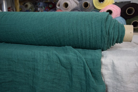 Linen fabric Pura Absolute Green. Thin semi-sheer gauze. 100% linen 110gsm. Bold saturated dark green. Washed-softened.
