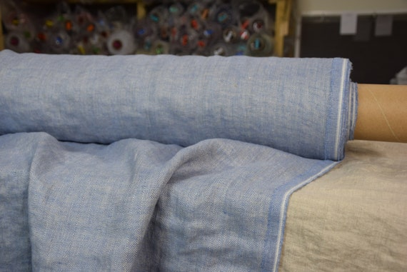 Pure 100% linen fabric Paloma Topaz Blue Herringbone 220gsm. Woven from undyed flax and light blue. Washed-softened.