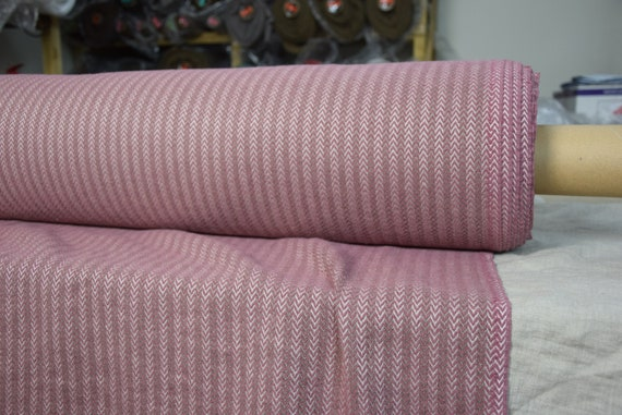 Linen/wool 45/40% fabric Dora Mauve Small Herringbone 270gsm. Woven from muted purple and beige yarn. Washed, softened, pre-shrunk.