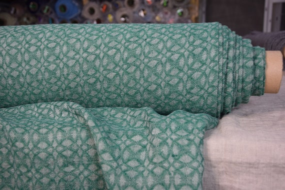 Pure 100% linen fabric Nora Green 210gsm. Small abstract-floral jacquard pattern woven from green and undyed flax colors. Washed-softened.