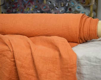 Very thin 95gsm semi-sheer pure 100% linen fabric. Dusty orange color (Pumpkin Orange). Washed-softened.