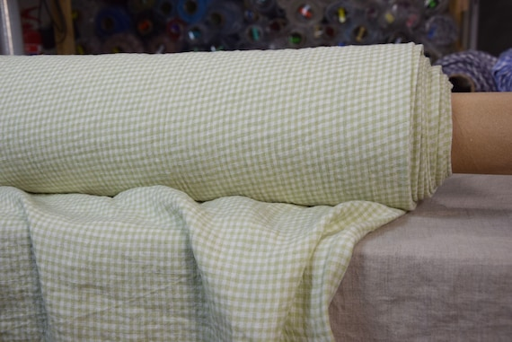 Pure 100% linen fabric Aurora Greenish Gingham 165gsm. 4mm checks woven from light green and off-white. Washed-softened.