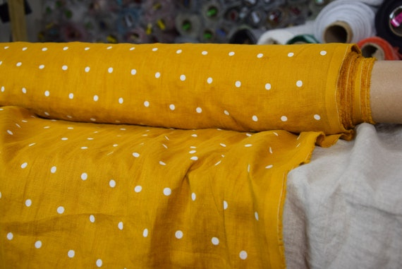 Pure 100% linen fabric Aura Curcumin Yellow Polka Dot 125gsm. White dots on bright yellow (turmeric tint) background. Washed-softened.