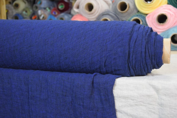 Linen fabric Pura Blackened Indigo Melange. Thin semi-sheer gauze. 100% linen 110gsm. Blue. Navy. Loosely woven. Washed-softened.